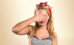 48570960 - pin-up girl covering her eyes
